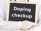 Doctor shows information on blackboard: doping checkup poster