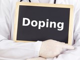 Doctor shows information on blackboard: doping poster