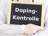 Doctor shows information on blackboard: doping test poster