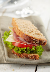 fresh deli sandwich with tomatoes, swiss chees, lettuce