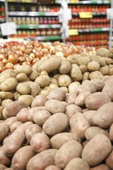 Potatoes and onions in a big grocery