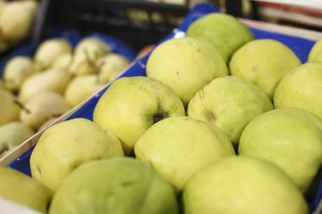 Appetizing quince in supermarket