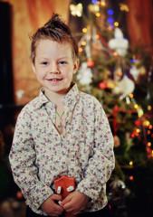 Christmas tree node emotional boy with a stylish haircut