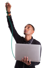 Young african american computer scientist plugin a ethernet cabl
