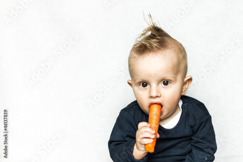 punk baby eating carrot