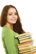 A smiling woman holding books, isolated on white