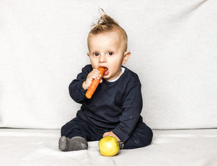 punk baby eating fruits and vegetables