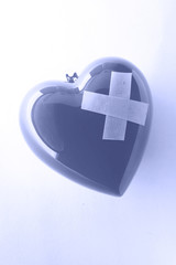 A symbol of heart with adhesive plaster in blue color