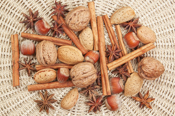 Spices for Christmas of cinnamon, star anise, walnuts, hazelnuts