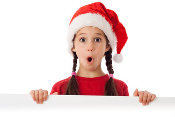 Girl in Christmas hat with empty banner