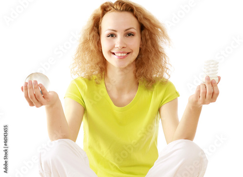 A woman with an energy-saving bulb meditating