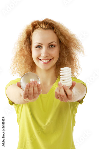 A young woman with an energy-saving bulb