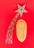 Fototapety Falling star, christmas decoration and a carving of the baby Jez