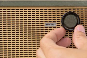 hand adjust vintage radio tuning knob concept