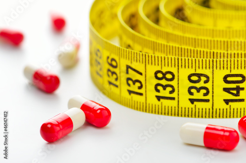 Diet pills and measuring tape