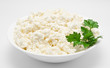 Fresh cottage cheese in the bowl isolated