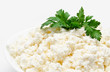 Fresh cottage cheese in the bowl with parsley isolated