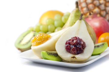 Fruits and pears with jam closeup luxury food concept on white
