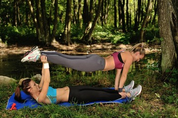 two girl's practising fitness in nature