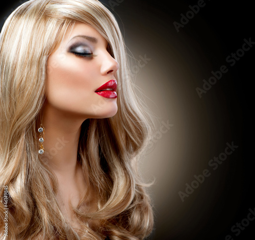 Beautiful Blond Woman with Holiday Makeup over Black