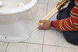 Plumber fixing bidet with silicone cartridge, washroom