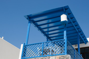 Blue wooden balcony, typical architecture of Dodecanese Island