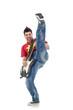 guitarist kicking while performing