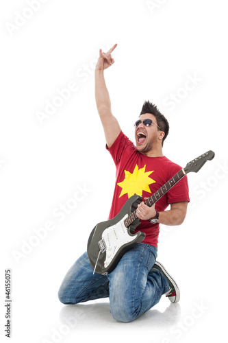 guitarist on his knees rock sign