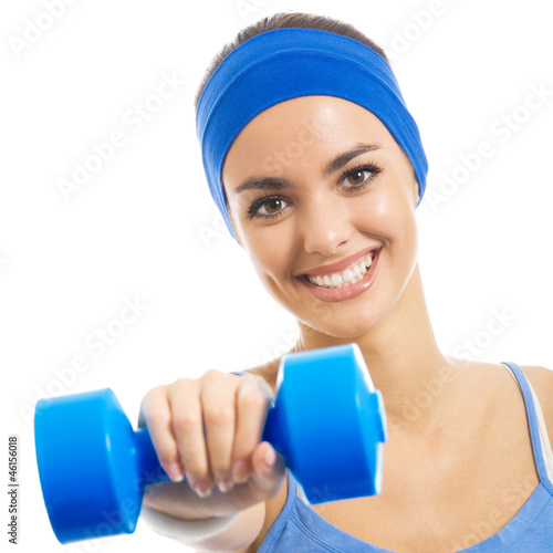 Cheerful woman exercising with dumbbell, over white