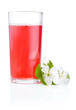 Glass of cherry juice and flowers isolated on white background