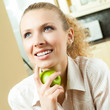Happy smiling woman with apple