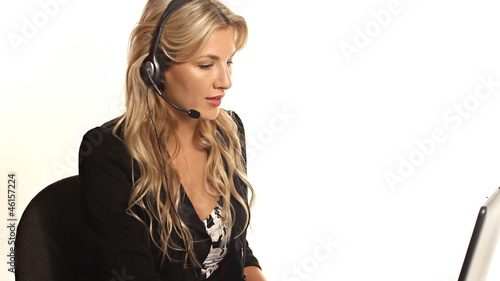 Pretty blond business woman helping with customer service