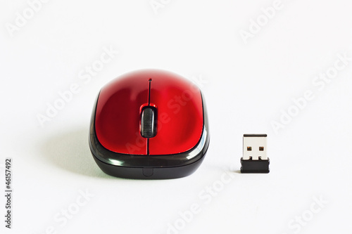 A red mouse on white table