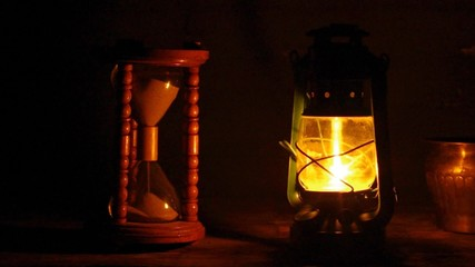 hourglass and oil lamp