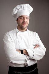Handsome chef posing