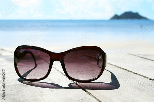 Sunglasses and sea