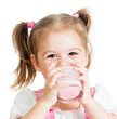 little child girl drinking yogurt or kefir over white