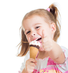 happy kid girl eating ice cream and showing thumb up
