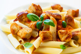 Pasta with roasted chicken and tomato sauce - shallow DOF