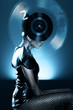 Attractive african woman with vinyl record on head
