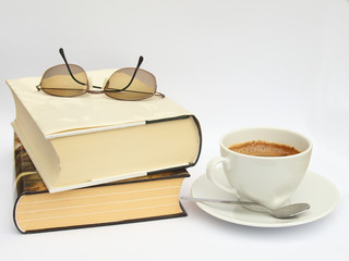 Readers still life with books, eyeglasses an cup of coffee