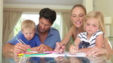 Family Drawing Picture Together At Home