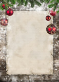 Christmas theme with blank paper on wooden planks