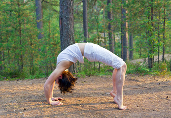 Woman in yoga bow pose