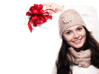 Pretty young woman holding gift about her head