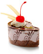 Chocolate pastry with cream and cherry isolated