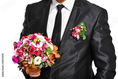 Red wedding bouquet in man's hand