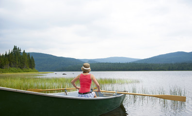 Female canoeing on Lake Noel in Quebec