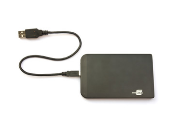 Portable external hard disk drive with USB cable on white backgr