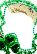 A green shamrock with beads and gold coins as a border